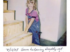 Sam helping her dad to build stairs at the new shop in 1998